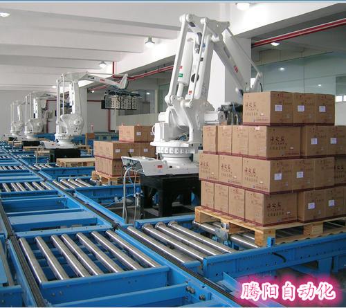 腾阳全自动码箱机是将箱装物进行码垛搬运的自动化设备